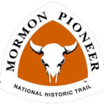 Mormon Pioneer NHT triangle-shaped sign features a bull skull against an orange background.