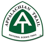 The Appalachian NST logo is a triangle-shaped trail sign with the letters A and T in white stacked on top of each other against a dark green background