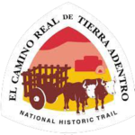 The CARTA NHT triangular logo and sign features two brown oxen pulling a wooden cart against a red, pink, and yellow background