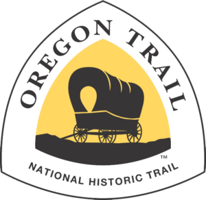 Oregon National Historic Trail marker is a triangle-shaped sign featuring a brown or black covered wagon against a yellow background