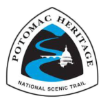 The Potomac Heritage National Scenic Trail triangular sign logo features a blue river winding through black hills with a white silhouette of the capital building in the center-right of the image.