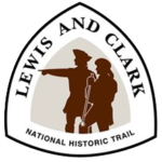 Triangular trail sign for the Lewis and Calrk NHT features the outlines of Lewis and Clark in red with one pointing forward