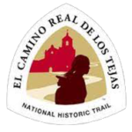 El Camino Real de los Tejas NHT triangular sign features the silhouette of a young woman in front of a Spanish mission