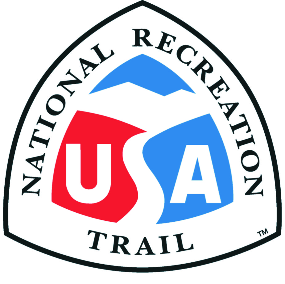 """Triangular National Recreation Trail logo features red and blue hills divided by a white trail that forms the """"S"""" in """"USA"""""""